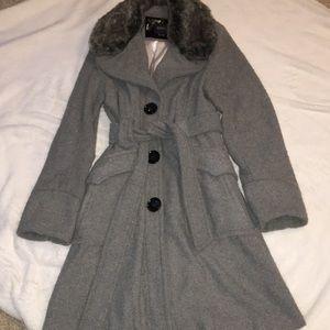 Grey knee length dress coat with fur trim collar